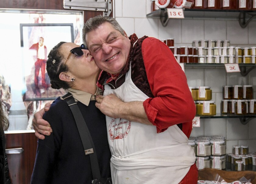 Los Angeles chef Nancy Silverton, a co-host of a Tuscany culinary tour, kisses butcher Dario Cecchini of Antica macelleria Cecchini in Panzano, Italy.