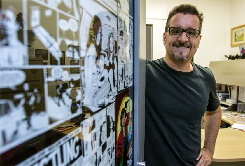 Rocco Versaci in his comics-decorated office at Palomar College in San Marcos, where he serves as chair of the English department.