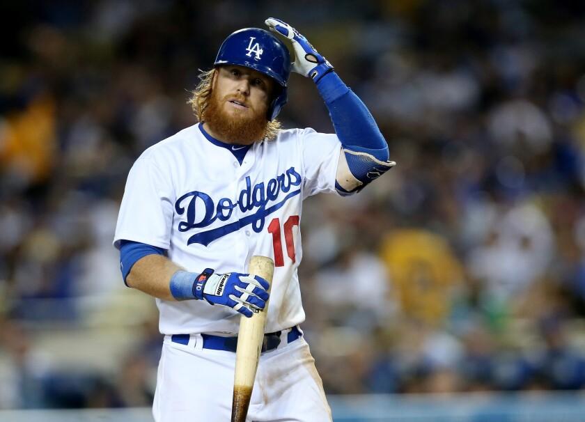 Dodgers third baseman Justin Turner adjusts his helmet before an at-bat against the Pirates.