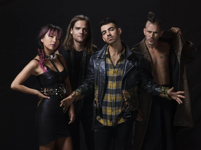 DNCE, from left: Guitarist JinJoo Lee, drummer Jack Lawless, singer Joe Jonas and dacrobatic bassist Cole Whittle. (Courtesy photo)