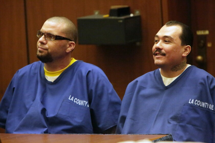 Marvin Norwood, 34, left, and Louie Sanchez, 32, who both admitted to assaulting a San Francisco Giants fan at a Dodgers game in 2011, appear in Los Angeles County Superior Court. Norwood later pleaded guilty to a federal weapons charge.