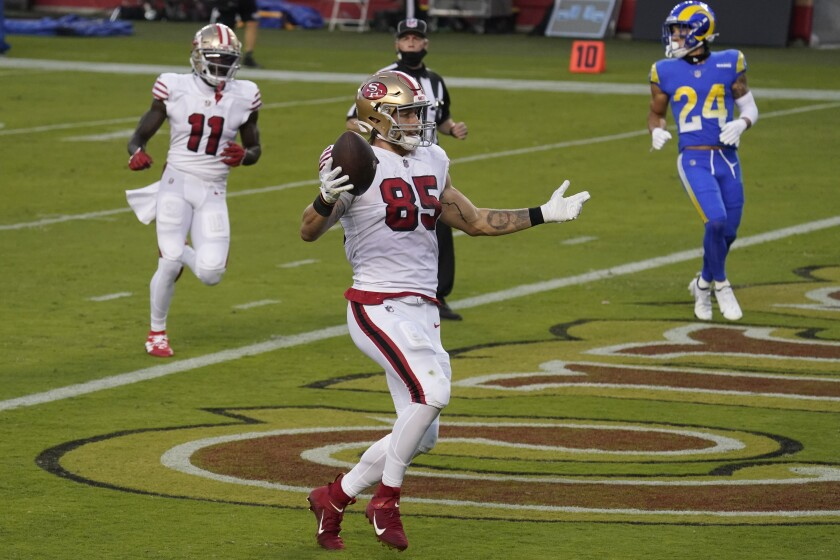 San Francisco 49ers tight end George Kittle (85) celebrates after scoring a touchdown against the Los Angeles Rams.