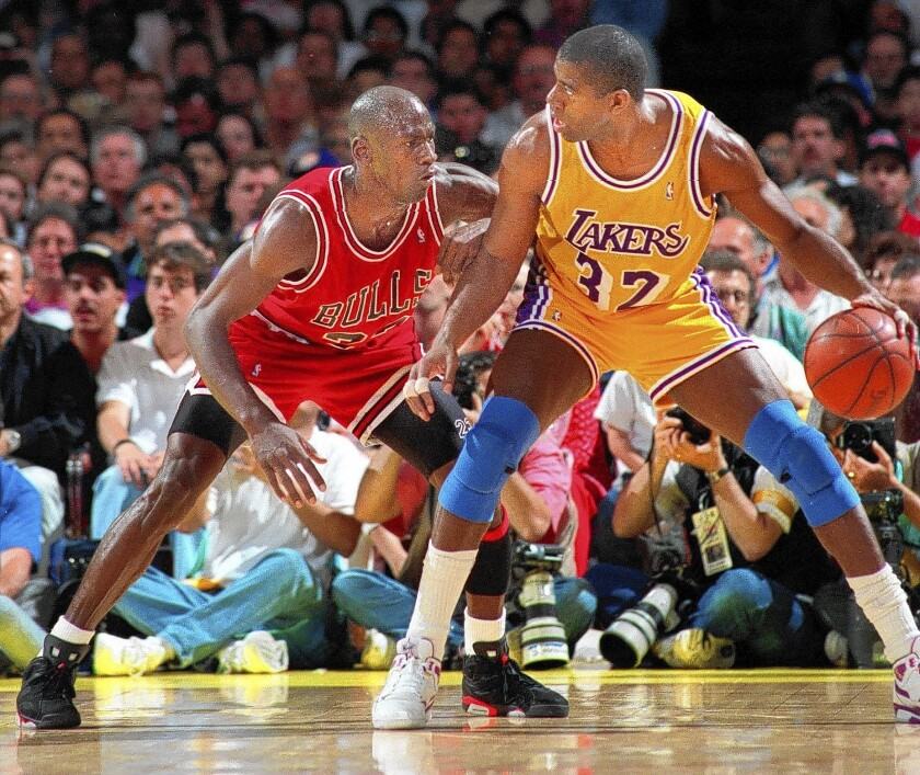 Lakers Magic Johnson tries to move past the Chicago Bulls' Michael Jordan during the NBA Finals in 1991.