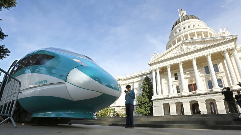 FILE - In this Feb. 26, 2015 file photo, a full-scale mock-up of a high-speed train is displayed at