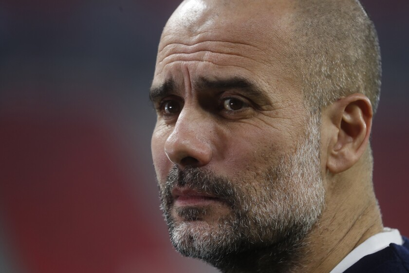 Manchester City's head coach Pep Guardiola ahead of the Champions League round of 16 first leg soccer match between Borussia Monchengladbach and Manchester City at the Puskas Arena stadium in Budapest, Hungary, Wednesday, Feb. 24, 2021. (AP Photo/Laszlo Balogh)