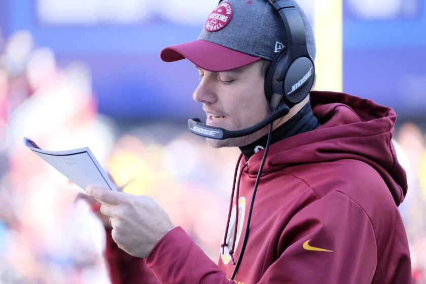 Washington Redskins offensive coordinator Kevin O'Connell calls a play.