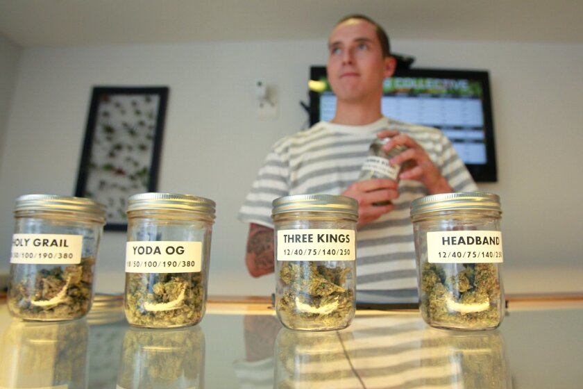 David Pizza works at the counter at Outliers Collective near El Cajon, San Diego County's only legal medical marijuana dispensary. On Wednesday, the Board of Supervisors enacted a 45-day ban on new dispensaries.
