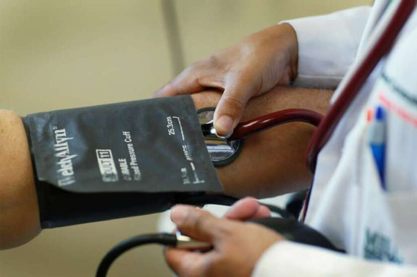 Doctors paid more attention to their patients' blood pressure and worked harder to adjust their medications when they were offered financial incentives, a study found.