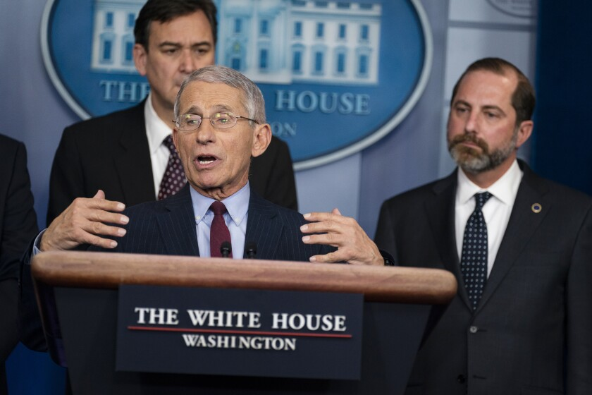 Dr. Anthony Fauci, director of the National Institute of Allergy and Infectious Diseases at the National Institutes of Health, speaks about the coronavirus at the White House on Jan. 31. Behind him are acting Under Secretary of Transportation for Policy at the Department of Transportation Joel Szabat (left) and Secretary of Health and Human Services Alex Azar.
