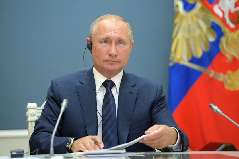 Russian President Vladimir Putin attends a video conference with Turkish President Recep Tayyip Erdogan and Iranian President Hassan Rouhani in Moscow, Russia, Wednesday, July 1, 2020. The three leaders discussed the situation in Syria and ways to promote a political settlement.(Alexei Druzhinin, Sputnik, Kremlin Pool Photo via AP)
