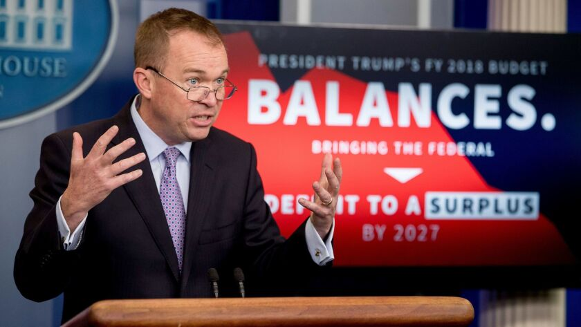 Budget Director Mick Mulvaney speaks to the media about Trump's proposed $4.1 trillion budget at the White House. The budget promises to balance government books after a decade, relying on aggressive cuts, a surge in economic growth — and a $2 trillion-plus accounting gimmick.