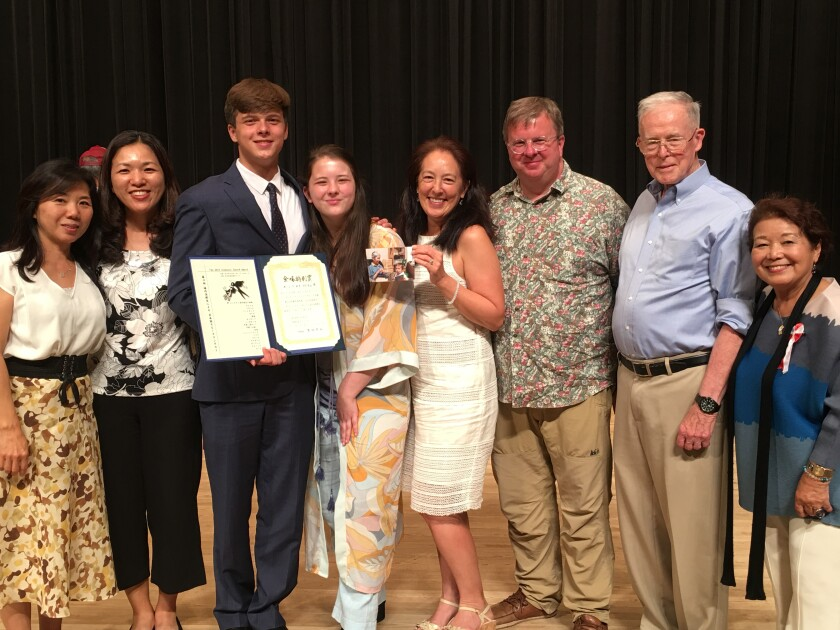 Zane Adlam with his family and support team after placing third in the International High School Japanese Speech Contest.