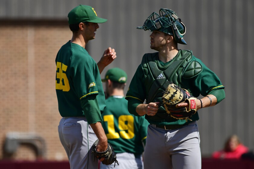 George Mason's Brian Marconi (35) is talked to by Logan Driscoll during the third inning of an NCAA college baseball game, at John W. Smithson Field Sunday, March 24, 2019, in Philadelphia. St. Joseph's defeated George Mason 14-3.
