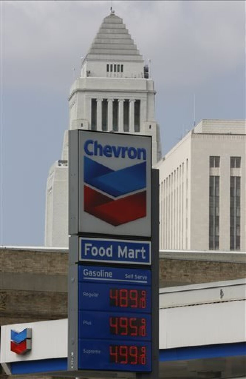 In this Thursday, Apr. 25, 2013, photo, the logo of Chevron is seen at a gas station downtown Los Angeles. Chevron Corp. reports quarterly financial results before the market opens on Friday, Aug. 2, 2013. (AP Photo/Damian Dovarganes)