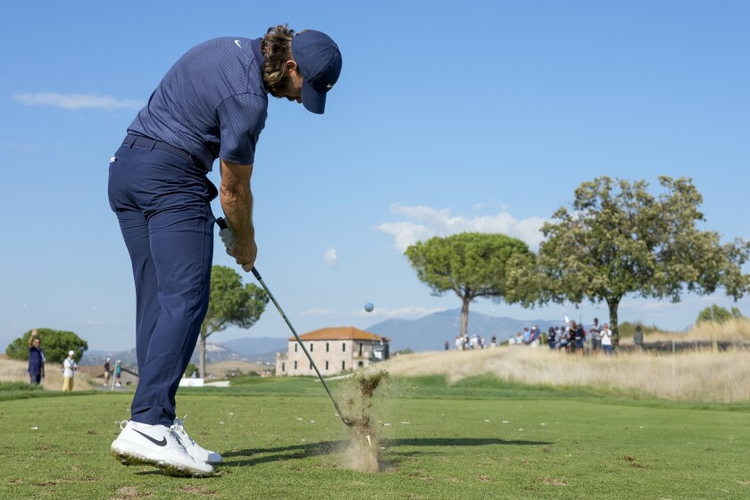 Tommy Fleetwood hits a tee shot during the first round of the Italian Open golf tournament, in Guidonia, in the outskirts of Rome, Thursday, Sept. 2, 2021. (AP Photo/Andrew Medichini)