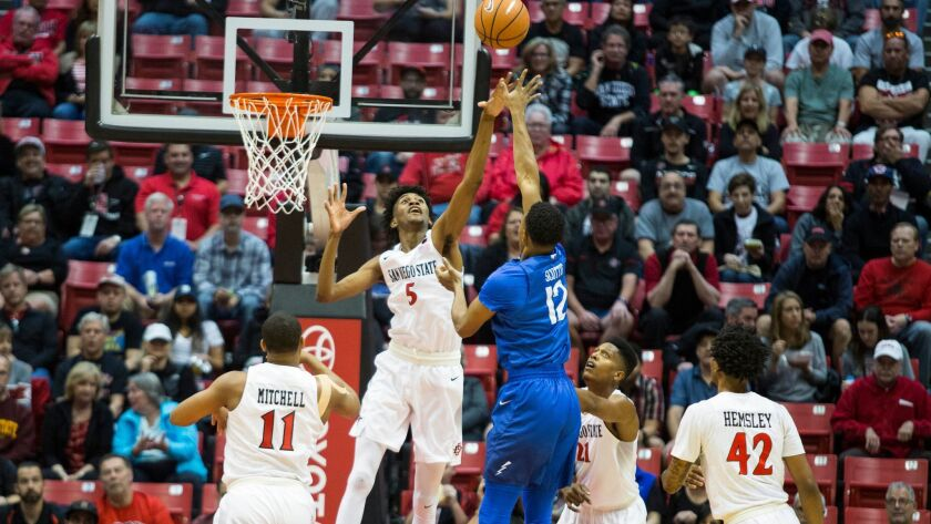 SDSU forward Jalen McDaniels tries to block a shot from Air Force forward Lavelle Scottie in the first half.