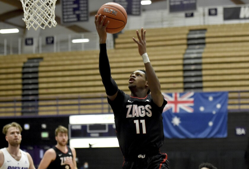 Gonzaga University guard Joel Ayayi, drives to the basket during the first half of an NCAA college basketball game against Portland in Portland, Ore., Saturday, Jan. 9, 2021. (AP Photo/Steve Dykes)