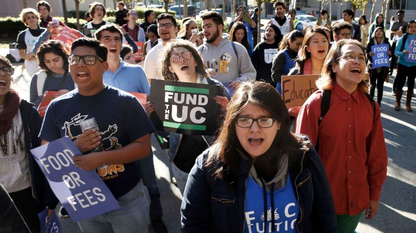 University of California students protest fee increases outside a regents meeting in San Francisco.
