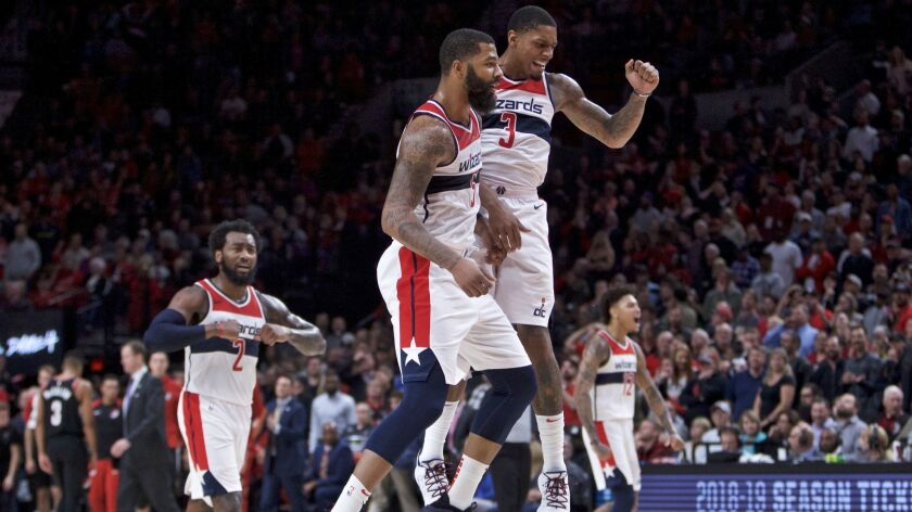 Washington Wizards forward Markieff Morris, left, and guard Bradley Beal celebrate during overtime against the Portland Trail Blazers.