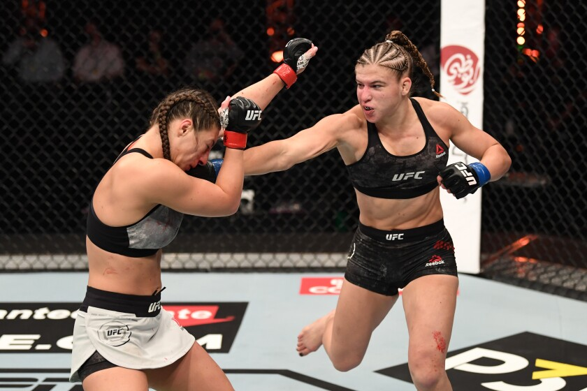 (R-L) Miranda Maverick punches Liana Jojua of Georgia in their women's flyweight bout during the UFC 254 event.