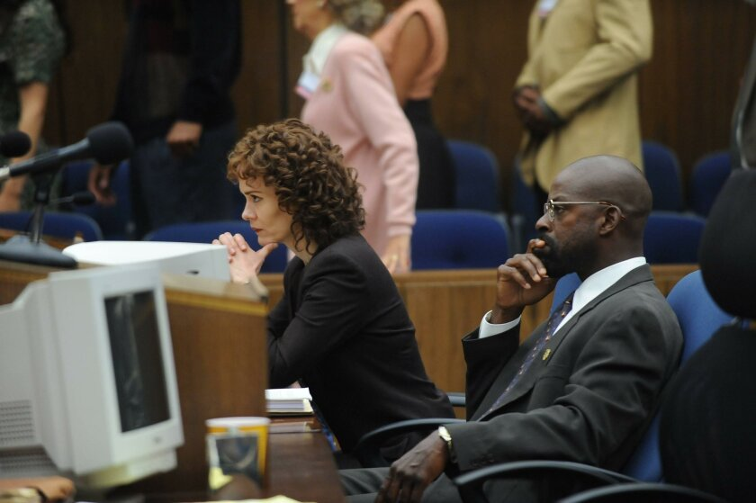 "In this image released by FX, Sarah Paulson portrays Marcia Clark, left, and Sterling K. Brown portrays Christopher Darden in a scene from ""The People v. O.J. Simpson: American Crime Story,"" a 10-part series."