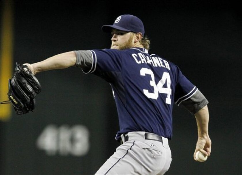 San Diego Padres' Andrew Cashner throws to an Arizona Diamondbacks batter during the first inning of a baseball game Tuesday, July 3, 2012, in Phoenix. (AP Photo/Ross D. Franklin)