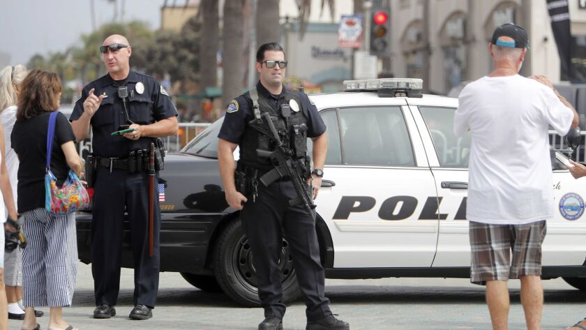 Huntington Beach police officers talked to the public as people waited for the Breitling Huntington