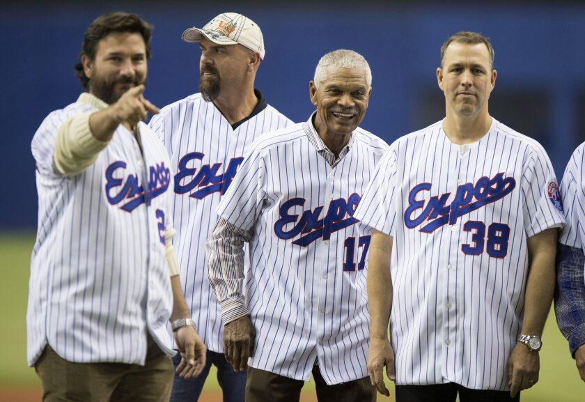 Former Montreal Expos (from left) Darren Fletcher, Larry Walker, manager Felipe alou and Denis Boucher.