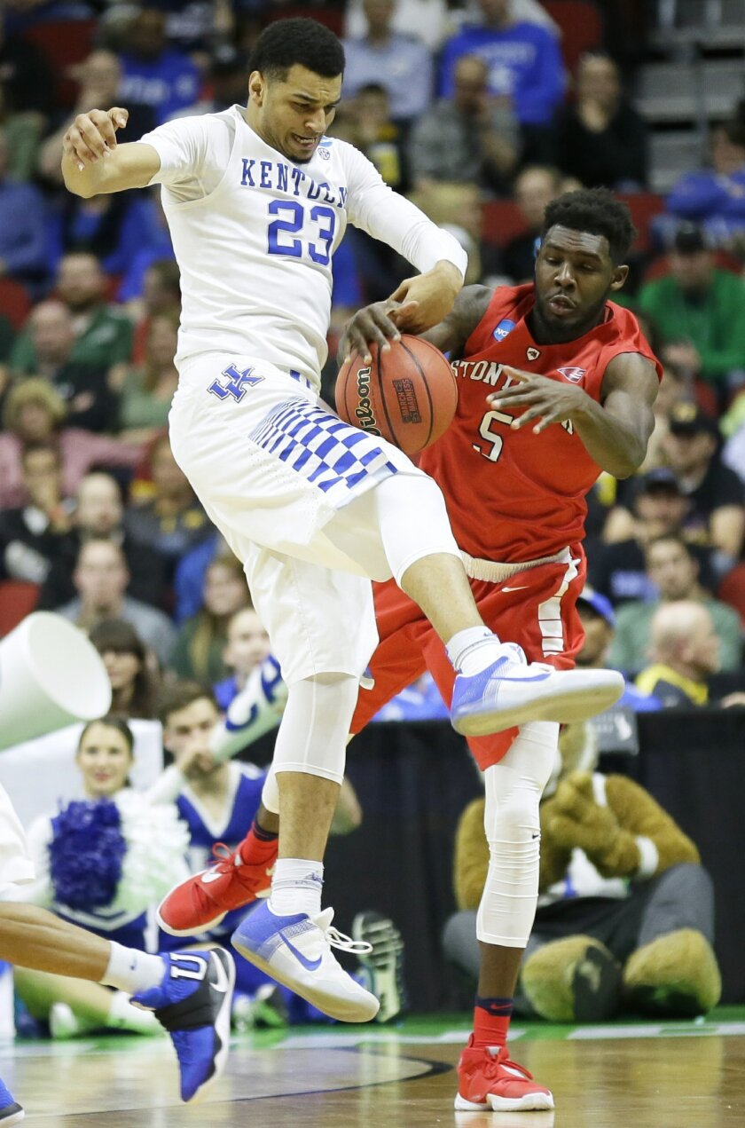 Kentucky guard Jamal Murray, left, steals the ball from Stony Brook guard Ahmad Walker during the first half of a first-round men's college basketball game in the NCAA Tournament, Thursday, March 17, 2016, in Des Moines, Iowa. (AP Photo/Charlie Neibergall)