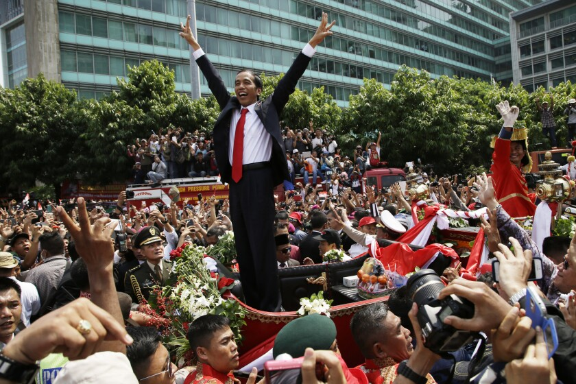 Indonesian President Joko Widodo gestures to the crowd during a parade following his inauguration in Jakarta on Oct. 20.