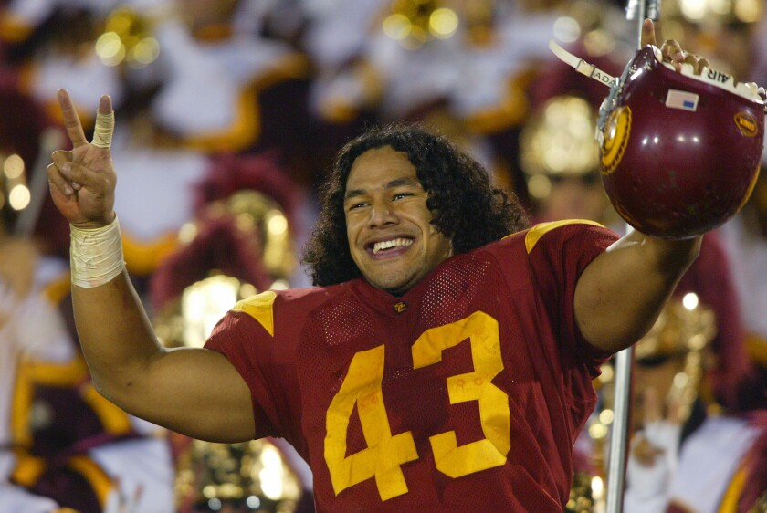 USC strong safety Troy Polamalu leads the team in a victory song after the Trojans defeated Notre Dame in 2002. Polamalu is among those named to the Polynesian Football Hall of Fame Class of 2016.