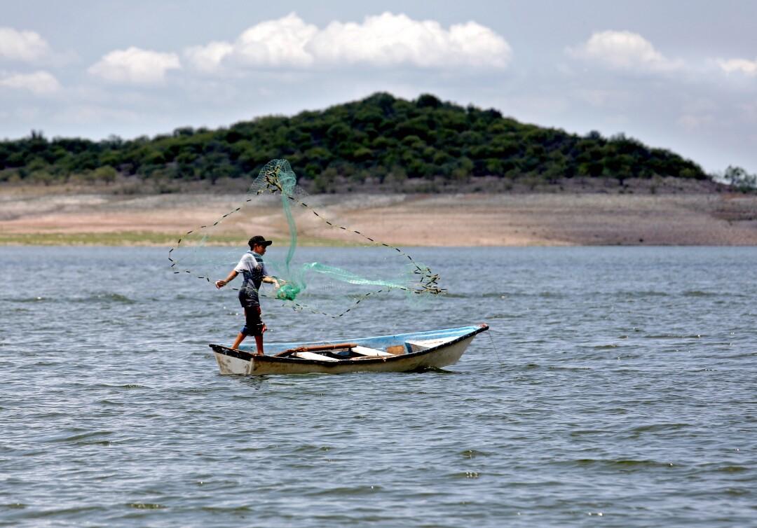 A fisherman on Agua Caliente reservoir