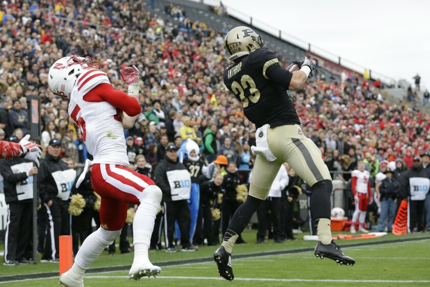 Purdue wide receiver Danny Anthrop (33) makes a catch in the end zone for a touchdown in front of Nebraska safety Nate Gerry (25) during the first half of an NCAA college football game in West Lafayette, Ind., Saturday, Oct. 31, 2015. (AP Photo/Michael Conroy)