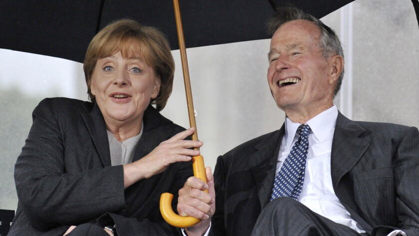 Former President George H.W. Bush and German Chancellor Angela Merkel at a July 2008 ceremony to inaugurate the new U.S. Embassy building in Berlin.