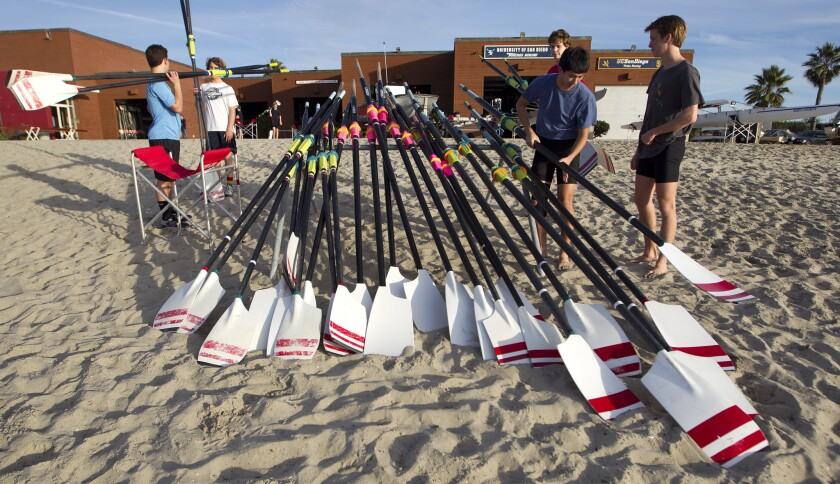 Members of the junior crew prepare the boat oars at the San Diego Rowing Club in Mission Beach.