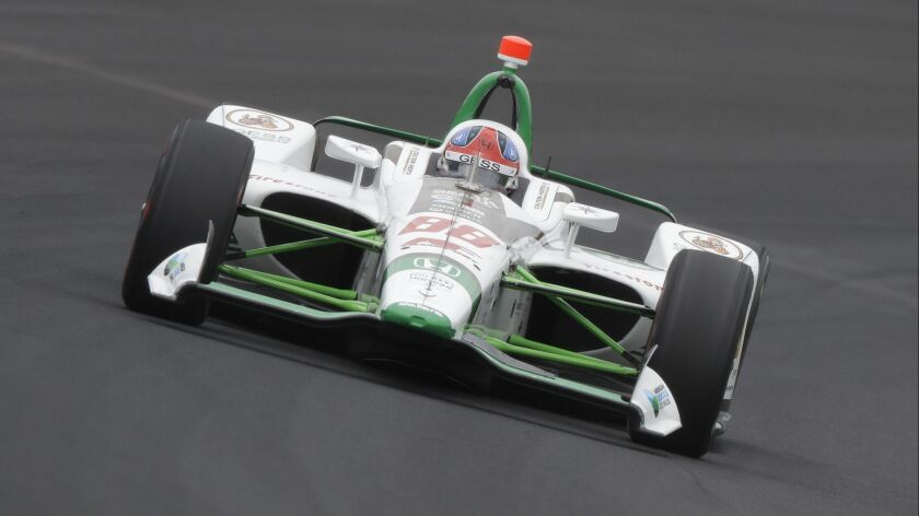Colton Herta drives through turn one during practice for the Indianapolis 500 IndyCar auto race at I