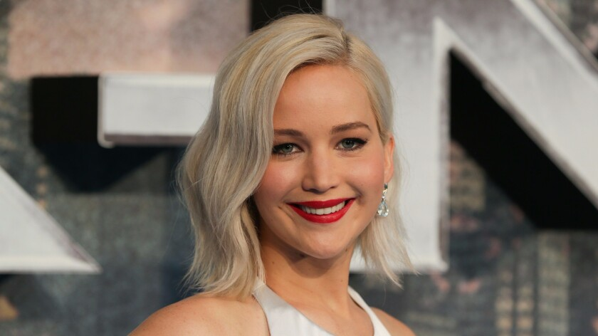 The parents of actress Jennifer Lawrence have sold one Santa Monica townhouse for $1.15 million and bought another for $2.725 million.