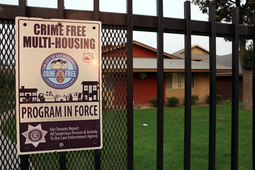 An apartment complex in San Bernardino displays a crime-free housing sign on its gate in September.