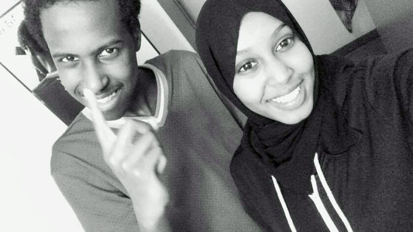 Seattle student Hamza Warsame, 16, left, with his sister, Ifrah Warsame, in 2015.