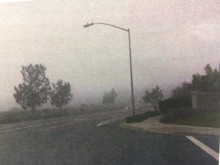 The intersection of East Ocean Air Drive and Vereda Sol del Dios on a foggy January day.