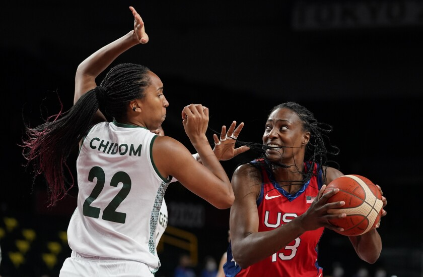 United States' Sylvia Fowles (13), right, drives past Nigeria's Oderah Chidom (22) during women's basketball preliminary round game at the 2020 Summer Olympics, Tuesday, July 27, 2021, in Saitama, Japan. (AP Photo/Charlie Neibergall)