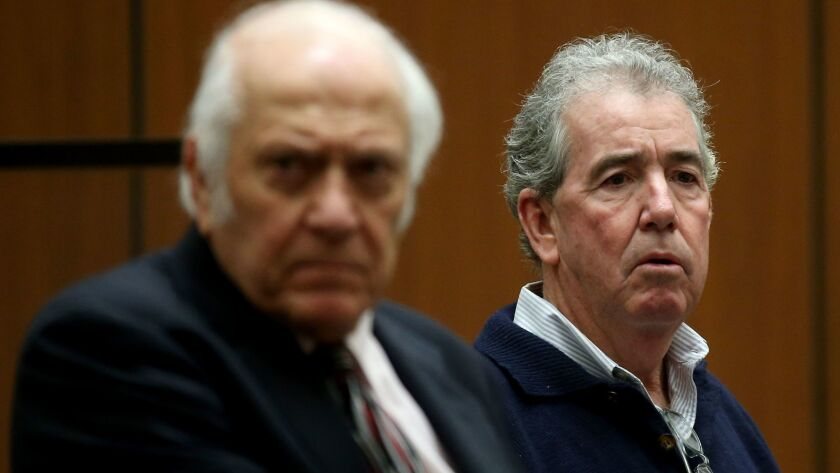 Patrick T. Lynch, right, the former general manager of the Los Angeles Memorial Coliseum, with his lawyer at a court hearing last month.