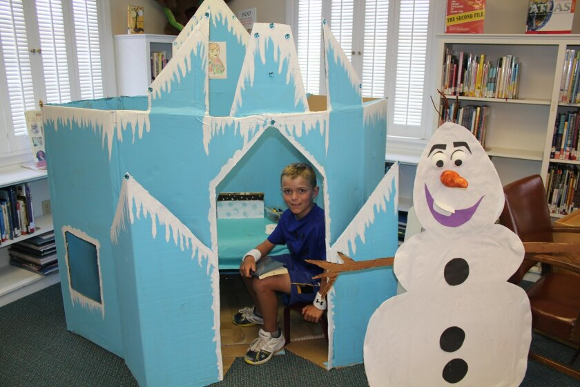 """Summer reader Christopher explores the """"Frozen"""" castle in the Rancho Santa Fe library while checking out books. Courtesy photo"""