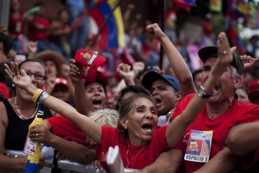 Supporters of Venezuela's President Hugo Chavez cheer during a campaign rally in Maracay, Venezuela, Wednesday, Oct. 3, 2012. Chavez is running for re-election against opposition candidate Henrique Capriles in presidential elections on Oct . 7. (AP Photo/Rodrigo Abd)
