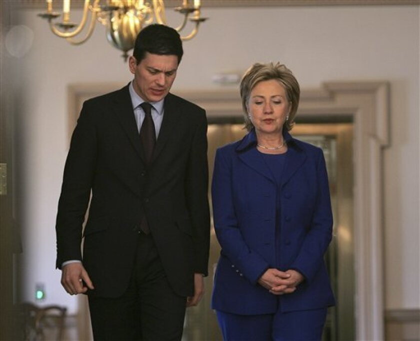 Secretary of State Hilary Rodham Clinton, right, walks out with Secretary of State for Foreign and Commonwealth Affairs of the United Kingdom of Great Britain David Miliband for a bilateral meeting, Tuesday, Feb. 3, 2009, at the State Department in Washington. (AP Photo/Lawrence Jackson)