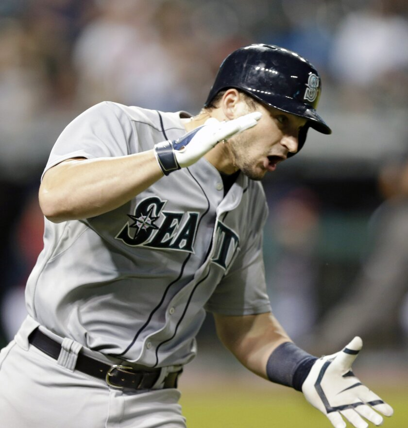 Seattle Mariners' Mike Zunino reacts after hitting a two-run home run off Cleveland Indians relief pitcher Bryan Shaw in the eighth inning of a baseball game Thursday, July 31, 2014, in Cleveland. Kyle Seager scored on the play. (AP Photo/Tony Dejak)