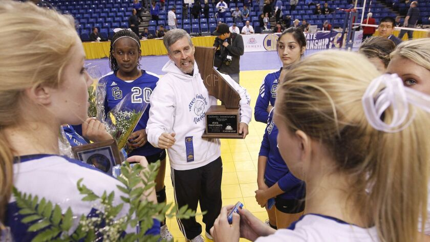 La Jolla Country Day head coach Peter Ogle, center, talks to his team as he holds the Division IV CI