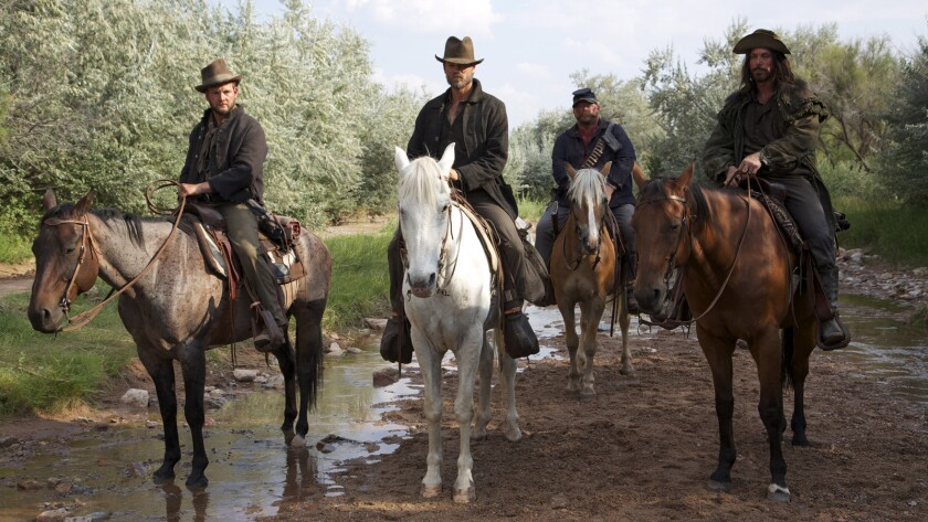 """Marty Lindsey, from left, Chad Michael Murray, Keith Loneker and Nathan Russell in the movie """"Outlaws and Angels."""""""