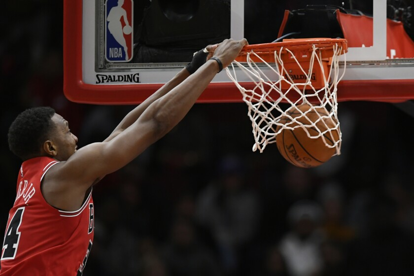 Chicago Bulls' Wendell Carter Jr. dunks during the first half of the team's NBA basketball game against the Detroit Pistons on Friday, Nov. 1, 2019, in Chicago. (AP Photo/Paul Beaty)