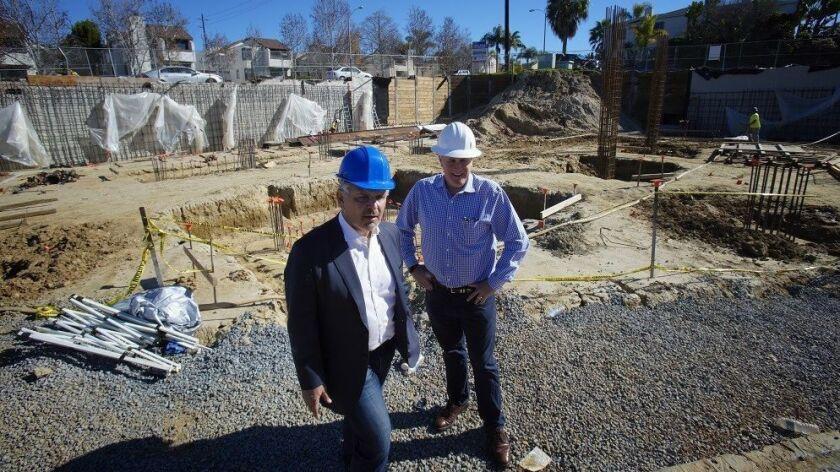At their construction site for the Nimitz Crossing in Point Loma, Rudy Medina (left) and Andrew T. L
